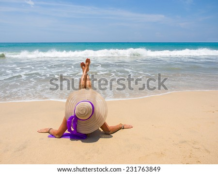 Woman with straw hat on the beach in Bali - stock photo
