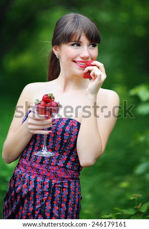 woman with strawberry in hand. - stock photo
