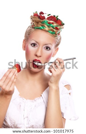 Woman with strawberry in her hairstyle over white background