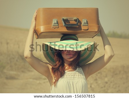 woman with suitcase - stock photo
