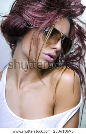 Woman with sunglasses and beautiful hair - stock photo