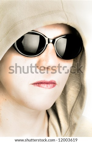 Woman with sunglasses and hood.