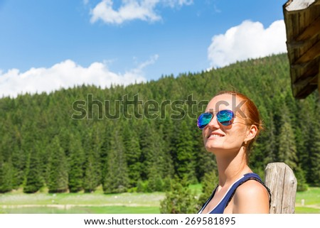 Woman with sunglasses in forest - stock photo