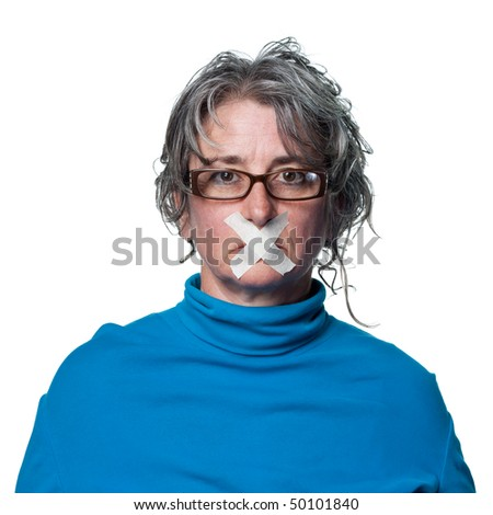 Woman with tape across her mouth, being silenced - stock photo
