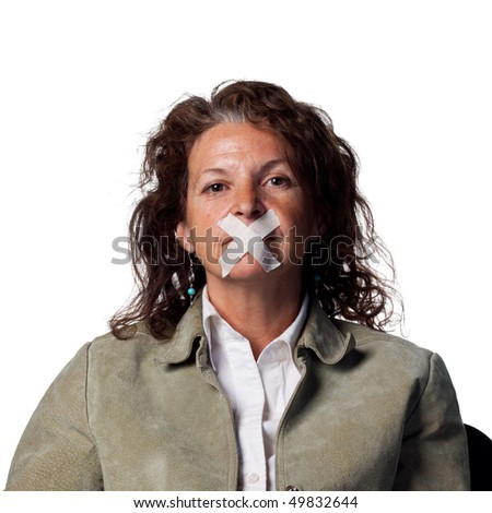 Woman with tape across her mouth - voiceless - stock photo