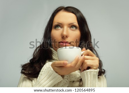 Woman with tea cup, sweet dreams - stock photo