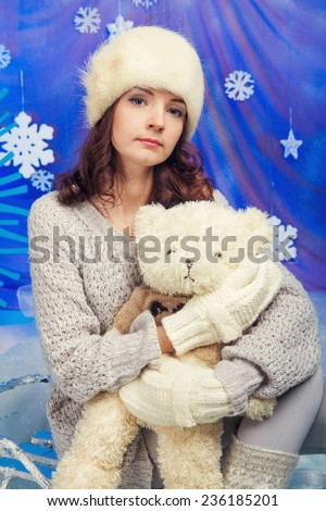 Woman with teddy bears with xmas tree near by - stock photo