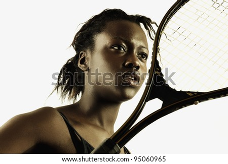 Woman with tennis racket - stock photo