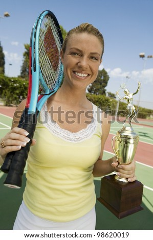 Woman with Tennis Rackets and Trophy
