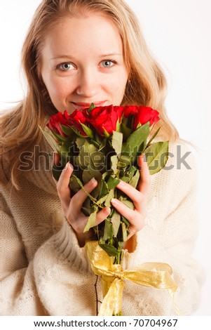woman with the bouquet of red roses