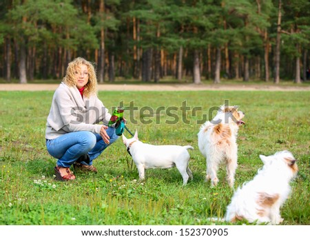 woman with the dogs in the park