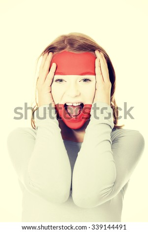 Woman with the flag of Austria painted on face. - stock photo