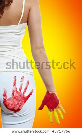 woman with the imprint of his hands on the ass - stock photo