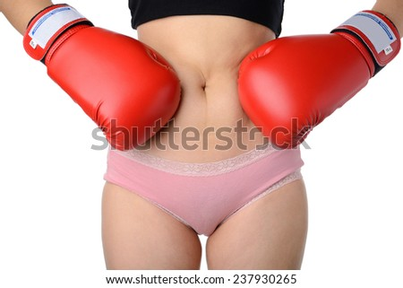 woman with the red boxing gloves fight with her belly, Diet concept - stock photo