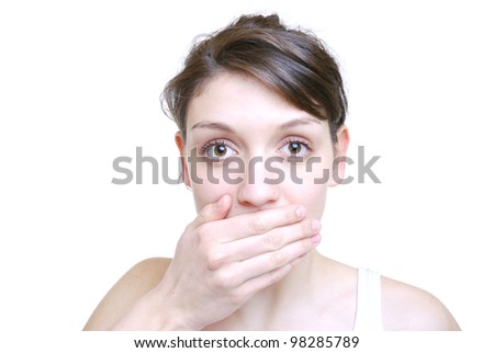 woman with the speak no evil gesture - stock photo