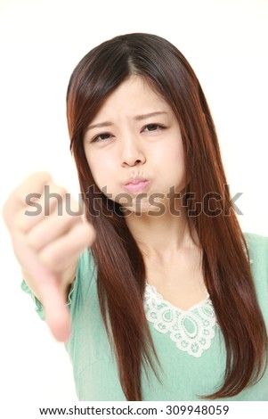 woman with thumbs down gesture