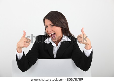woman with thumbs up - stock photo