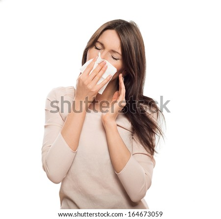 Woman with tissue catched a cold isolated on white - stock photo