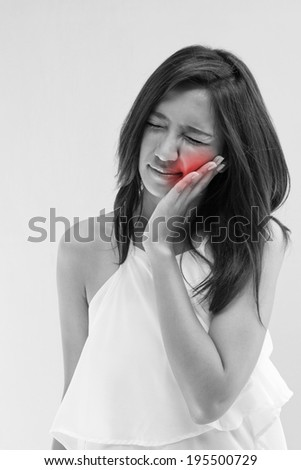 woman with tooth ache or oral problem with red alert accent - stock photo