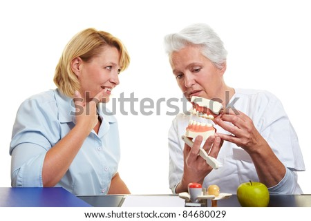 Woman with toothache at dentist showing her teeth - stock photo