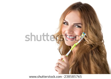 Woman with toothbrush. Isolated on white background. - stock photo