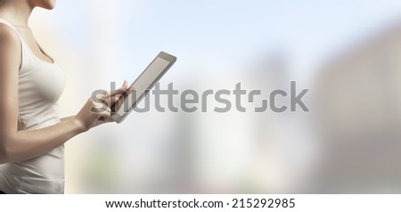 woman with  touch pad on white background - stock photo