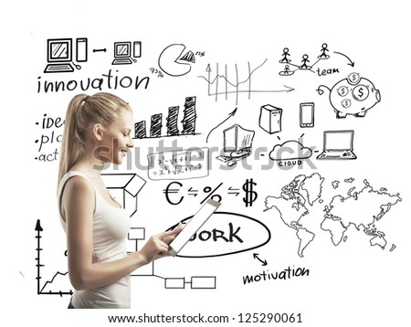 woman with touchpad and business scheme - stock photo