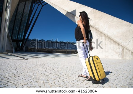 woman with trolley outside the lyon airport - stock photo