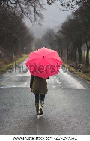 Woman with umbrella - stock photo