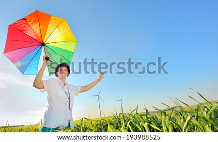 Woman with Umbrella on field