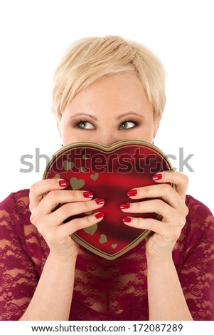 Woman with valentine's gift looking funny - stock photo