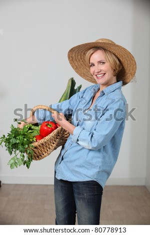 woman with vegetable basket - stock photo