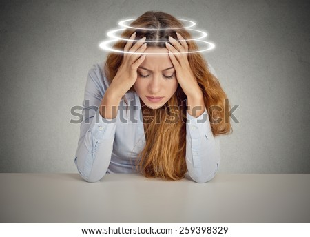 Woman with vertigo. Young female patient suffering from dizziness.  - stock photo
