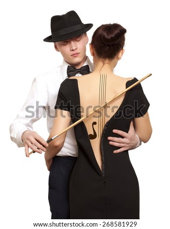 Woman with violin body art and man holding bow. Photo compilation, photo and hand-drawing elements - stock photo