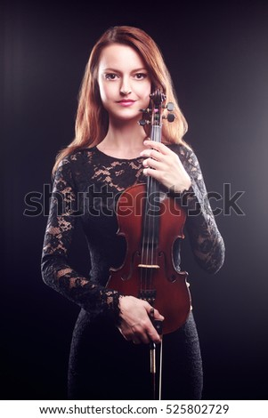 Woman with violin player violinist Classical musician portrait with music instrument