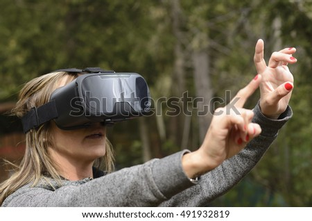 Woman with virtual reality glasses 360 degrees