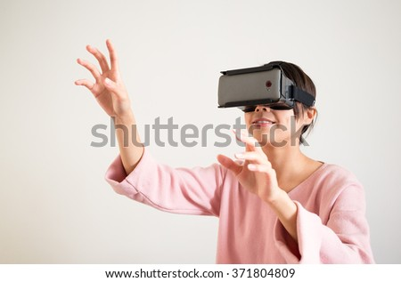 Woman with virtual reality headset - stock photo