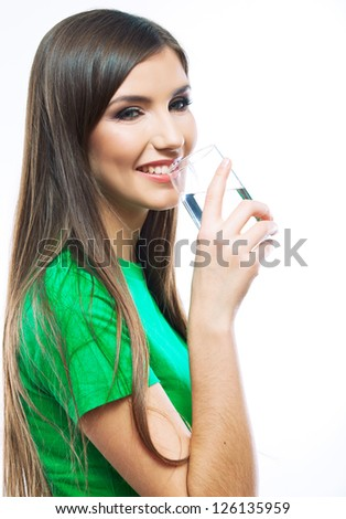 Woman with water glass standing against white background - stock photo