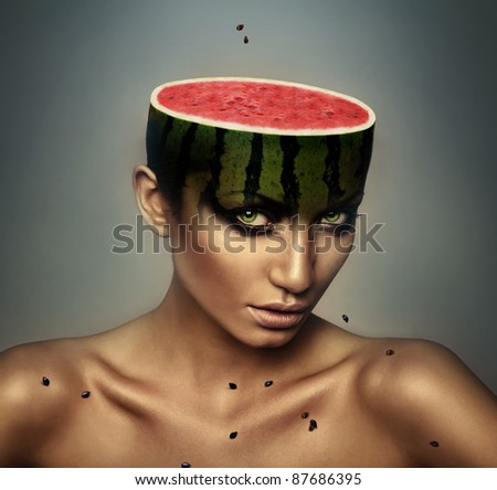woman with watermelon head and grains
