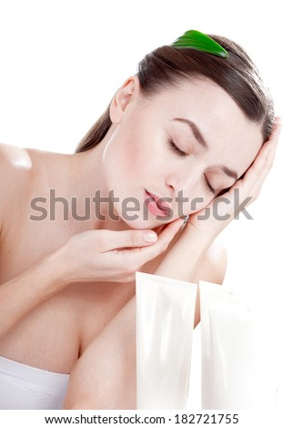 Woman with well-groomed skin near organic cosmetics - isolated on white background. Skin care concept. - stock photo