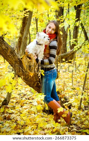 woman with west highland terrier in the park - stock photo