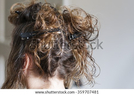 Woman with wet hair in hair salon.
