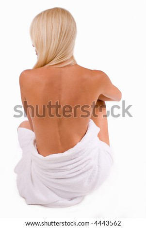 woman with white towel sitting from the back