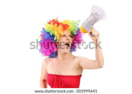 Woman with wig shouting on a megaphone isolated on white background - stock photo
