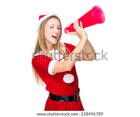 Woman with xmas dress yell with megaphone - stock photo