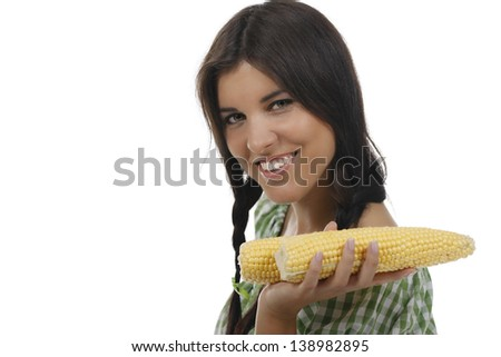 Woman with yellow corn cobs