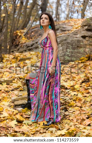 woman with yellow leaves in autumn - stock photo