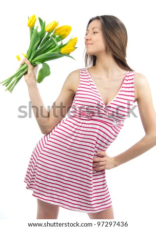 Woman with yellow tulips bouquet of flowers smiling isolated on white background - stock photo