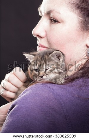 woman with young kittens in studio