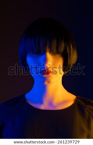 woman without emotion. portrait made in studio - stock photo